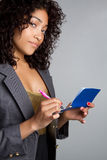 Checkbook Woman. Black business woman holding checkbook stock photo