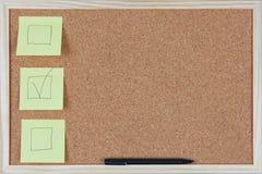 Checkbox post-it notes on corkboard Stock Image