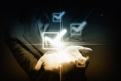 Checkbox tick. Close up of businessman holding icons in palms Stock Photography
