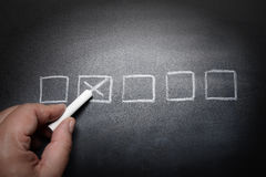 Checkboxes blackboard -concept. Checkboxes blackboard with hand -concept - idea Royalty Free Stock Photos