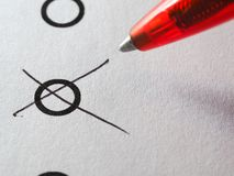 List of checkboxes. Checkboxes and red pen ballpoint marking one box on white background Royalty Free Stock Image