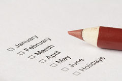 Checkboxes to choose month. And red pencil Stock Photos