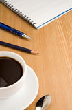 Checked binder pad and coffee Royalty Free Stock Photo