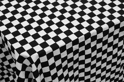Checked cloth. Black and white checkered cloth background stock photo