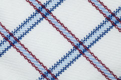 Checked cloth texture close up. Macro seamless checked blue, red and white fabric pattern texture background Royalty Free Stock Image