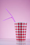 Checked Cup. Red checked cup and purple straws Stock Photos