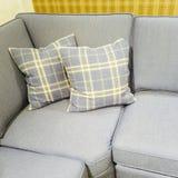Checked cushions on gray sofa Royalty Free Stock Photo
