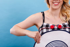 Checked dress, red buttons and sun hat Royalty Free Stock Photos