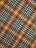 Checked fabric. Checked fabrc suitable as background Stock Photos