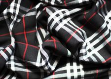 Checked fabric. Artistic backgroud. The bright scottish checked fabric Stock Image