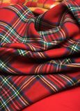 Checked fabric. Bright background. The red scottish checked fabric Stock Photo