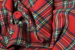 Checked fabric. The bright scottish checked fabric. Artistic background Royalty Free Stock Photo