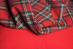 Checked fabric. The bright scottish checked fabric. Fashion background Royalty Free Stock Image