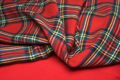 Checked fabric. The bright scottish checked fabric and red fabric Royalty Free Stock Photography