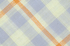 Checked fabric pattern. Close up seamless checked brown and purple fabric pattern texture background Royalty Free Stock Photography