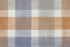 Checked fabric pattern texture. Close up seamless checked brown and purple fabric pattern texture background Stock Photography