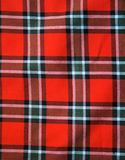 Checked fabric. Red checked scottish fabric.  Bright artistic background Royalty Free Stock Image