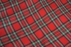 Checked fabric. The red scottish checked fabric. Bright background Stock Images