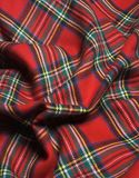 Checked fabric. The red scottish checked fabric. Bright background Stock Photography