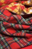 Checked fabric. The red scottish checked fabric. Bright background Royalty Free Stock Photos