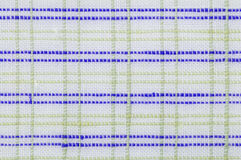 Checked fabric texture close up. Close up seamless checked green and purple fabric pattern texture background Stock Photography