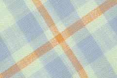 Checked fabric texture. Macro seamless checked yellow and purple fabric pattern texture background Stock Photo
