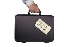 Checked Luggage. Male hand with black suitcase isolated on white royalty free stock photography