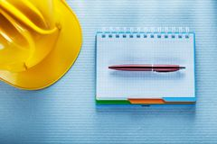 Checked notebook pen building helmet Royalty Free Stock Image