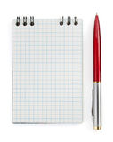 Checked notebook and pen on white Royalty Free Stock Image
