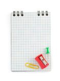 Checked notebook on white royalty free stock photography
