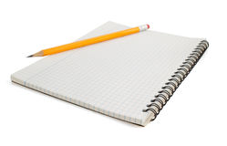 Checked notebook on white Stock Images