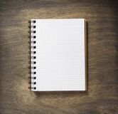 Checked notebook at wood stock image