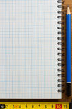 Checked notebook on wood Royalty Free Stock Photo