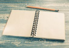 Checked notebook on wood royalty free stock photography