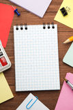 Checked notepad and office accessories Royalty Free Stock Image