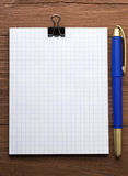 Checked notepad and pen Stock Images