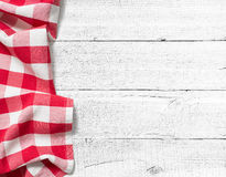Checked picnic tablecloth on white wood table Royalty Free Stock Photos