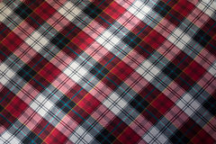 Checked plaid fabric in red, black and white from above Stock Photos