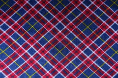 Checked plaid fabric in red, blue and white from above Stock Photography