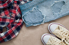Checked shirt, jeans and shoes Stock Photography