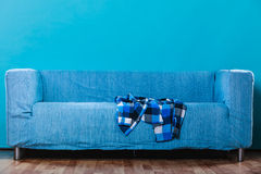 Checked shirt on sofa. Checked plaid dark blue and white shirt on sofa couch at home royalty free stock photo