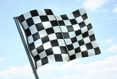 Checked sport flag. On sky background (done in 3d rendering Stock Photos