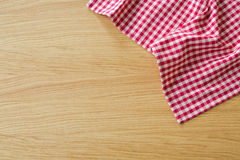 Checked tablecloth on wooden table. View from above with copy space Stock Image