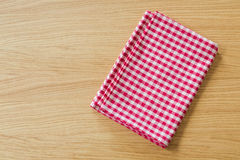 Checked tablecloth on wooden table. View from above with copy space Stock Photos
