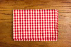 Checked tablecloth on wooden table Stock Photo