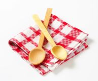 Checked tea towel and wooden spoons Royalty Free Stock Photo