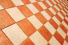 Checked tiles. Terracotta and cream tiles in a checked pattern stock photos