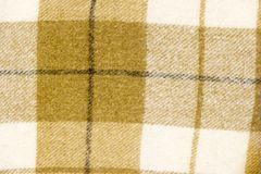 Checked wool fabric textured background. Cloth texture closeup Stock Photo