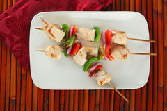Checken Kabobs on White Plate royalty free stock images