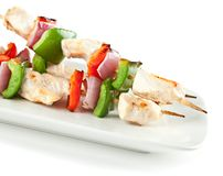 Checken Kabobs on White Plate Isolated Royalty Free Stock Photos